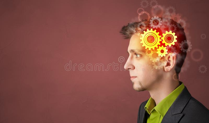 Portrait with gears concept stock photography