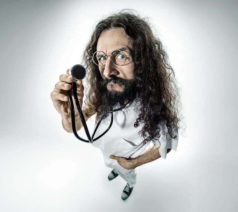 Portrait of a geek, skinny doctor. Portrait of a skinny, geek doctor royalty free stock photo