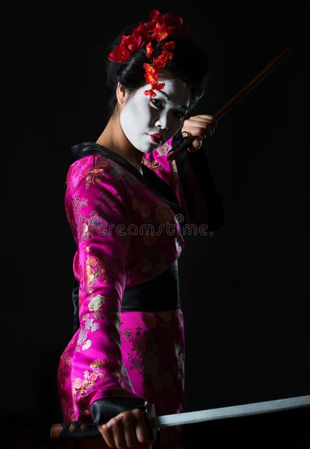 Portrait of geisha holding sword stock photos
