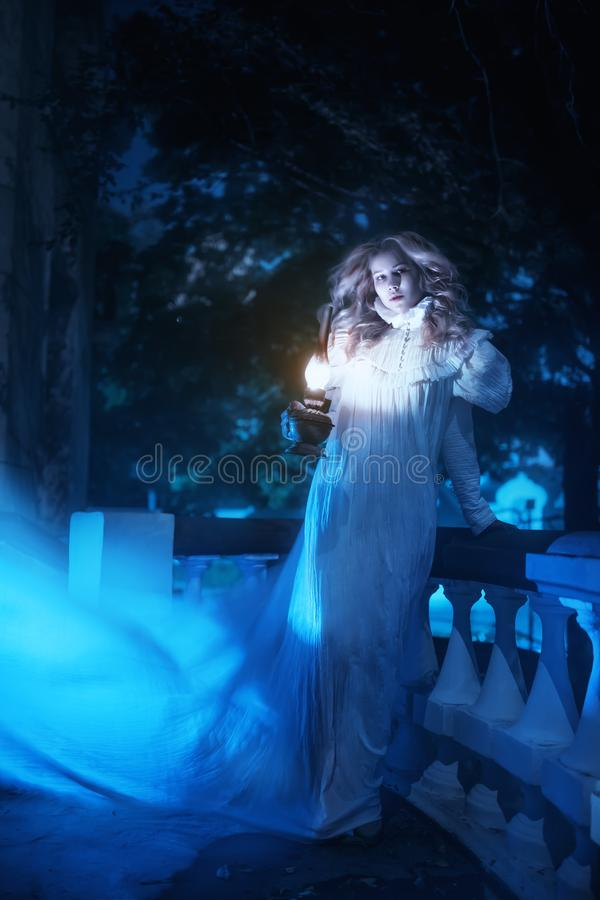 Ghost in night. Portrait of ghost girl in white dress walking in night stock photos
