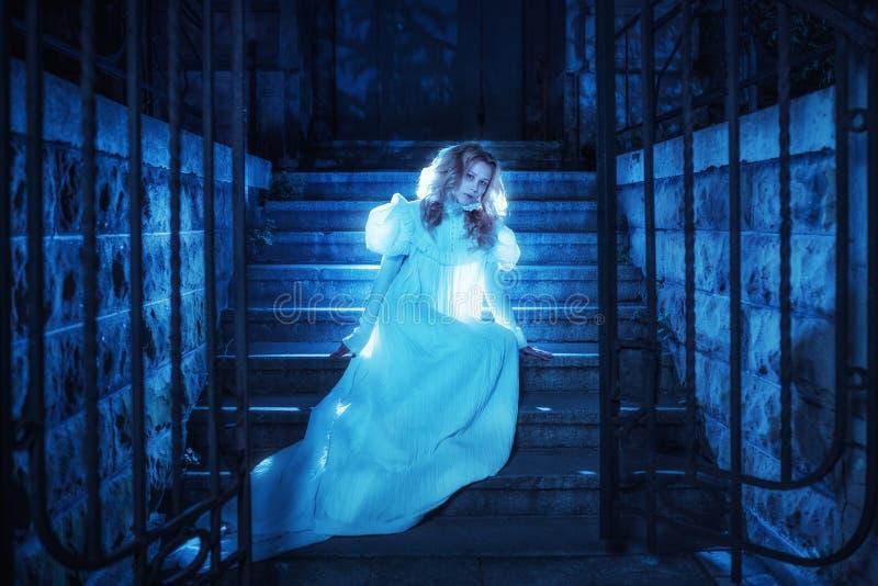 Ghost in night. Portrait of ghost girl in white dress walking in night stock photo