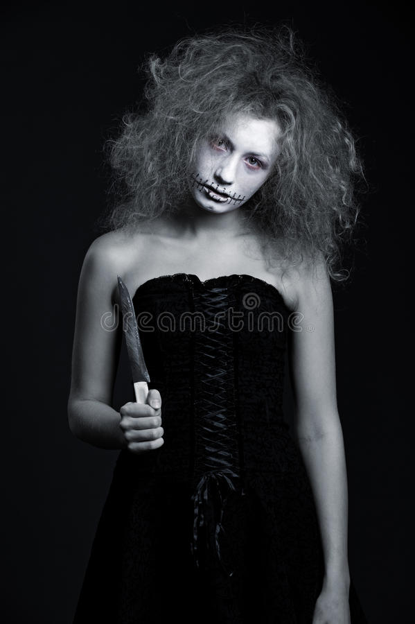 Portrait of ghost with knife. Halloween theme royalty free stock photography
