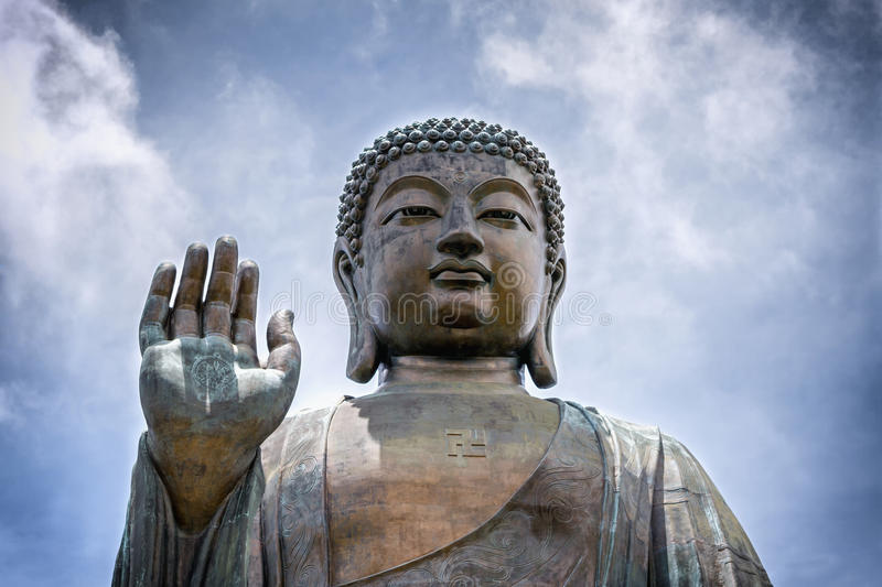 Portrait of a giant seated Buddha stock image