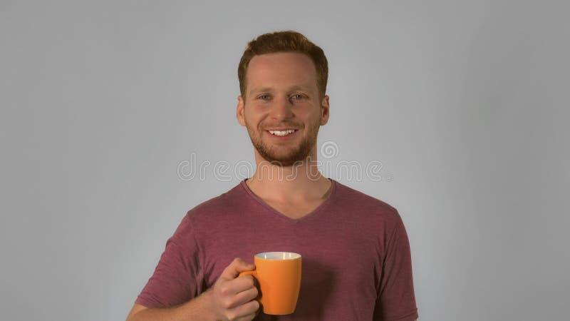 Portrait ginger enjoying drink stock photography