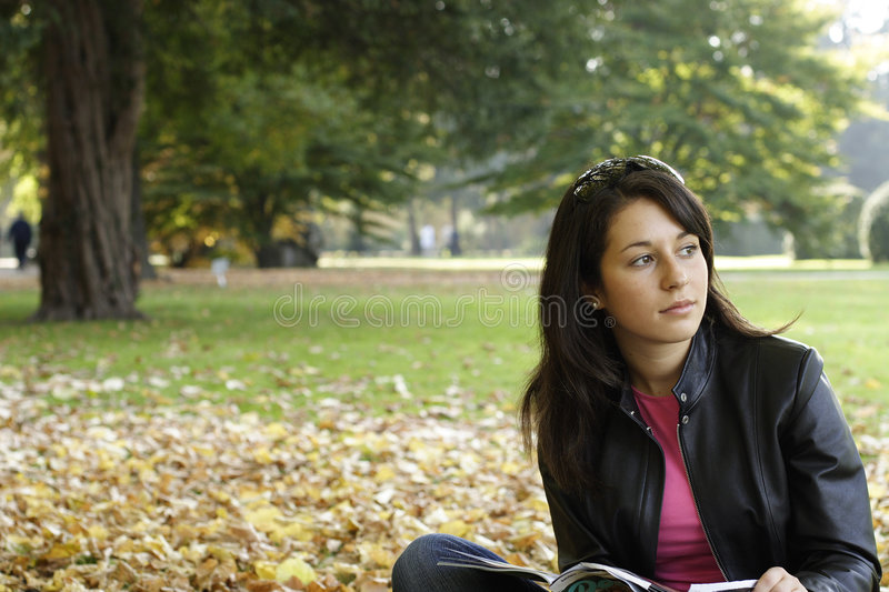 Portrait of a girl. In a park royalty free stock images