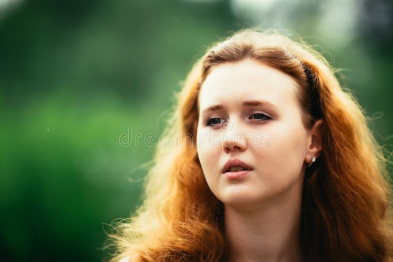 Portrait of a girl against a nature background royalty free stock image