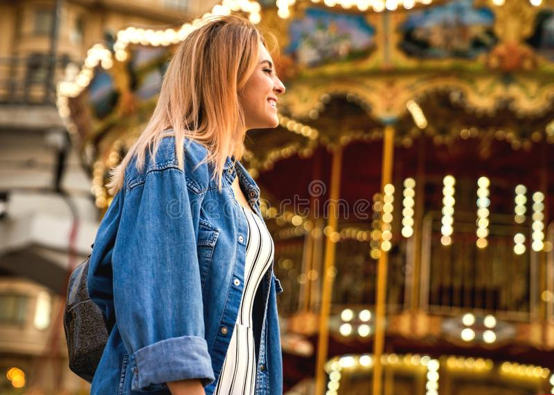 Portrait of a girl in American style on a swing laughs and rejoices.  royalty free stock photography