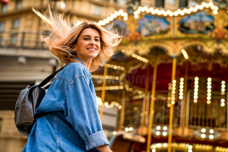 Portrait of a girl in American style on a swing laughs and rejoices.  royalty free stock images