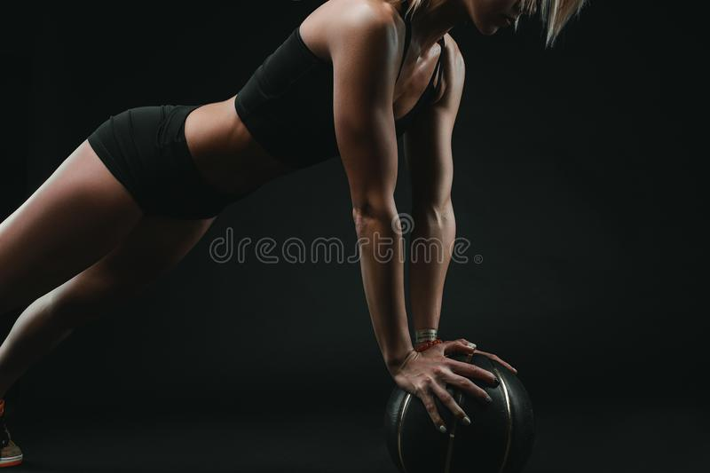 Athletic strong woman doing sport stock photography