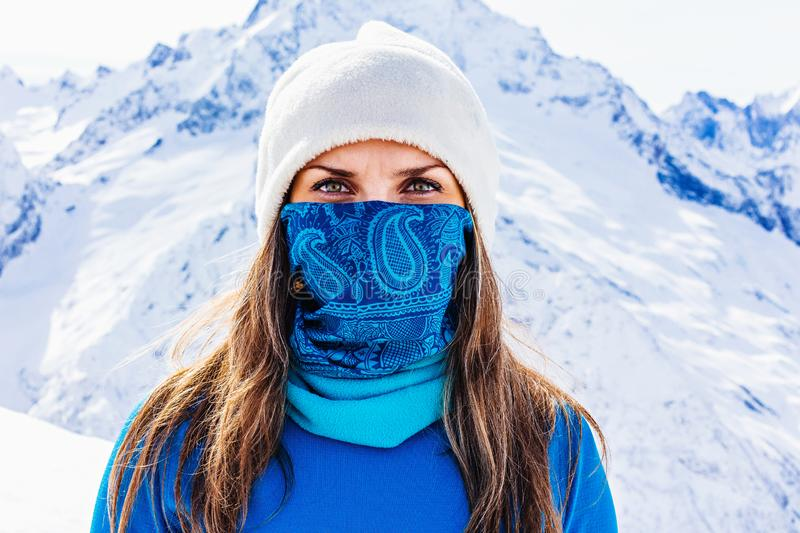 Portrait of a girl on the background of snowy peaks stock photography
