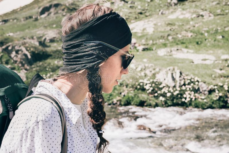 Portrait of a girl with a backpack in the mountains. royalty free stock photography