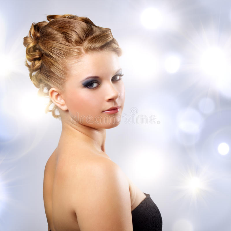 Portrait of a girl with beautiful hairstyle royalty free stock photography