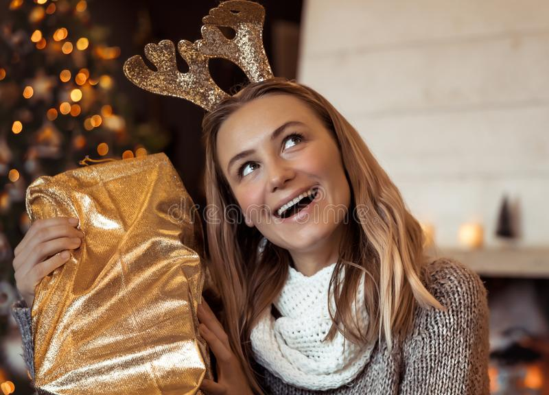 Pretty woman with Christmas gift stock images