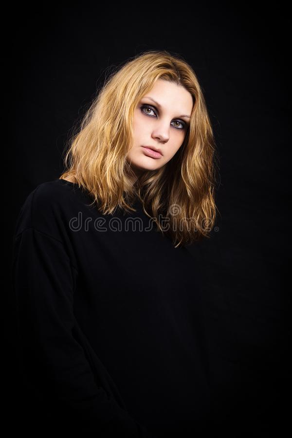 Portrait of a girl on black background with bright makeup royalty free stock photo