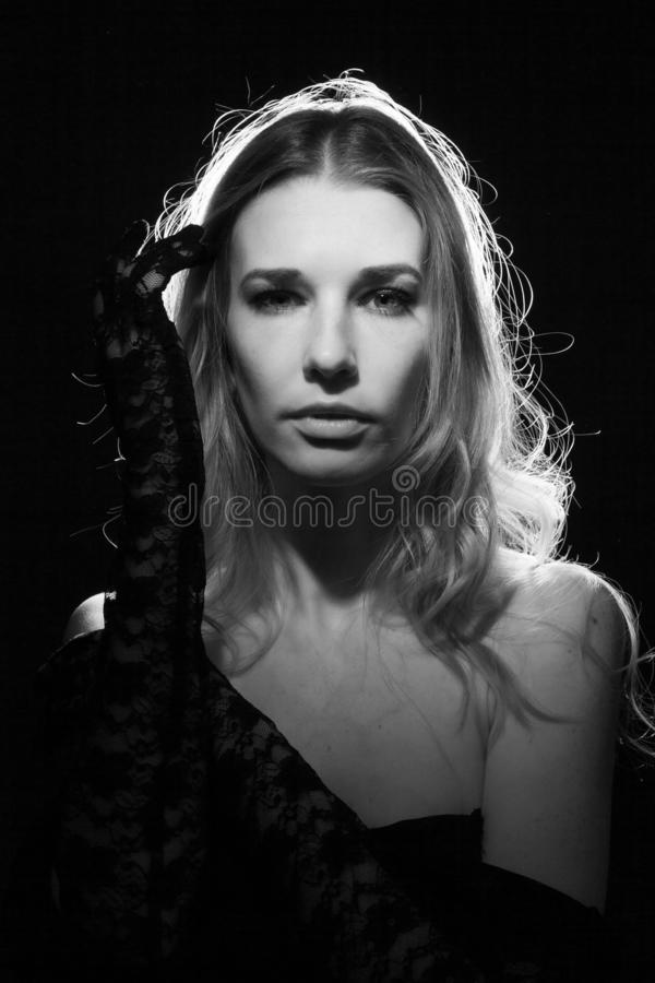 Portrait of a girl on a black background royalty free stock photography