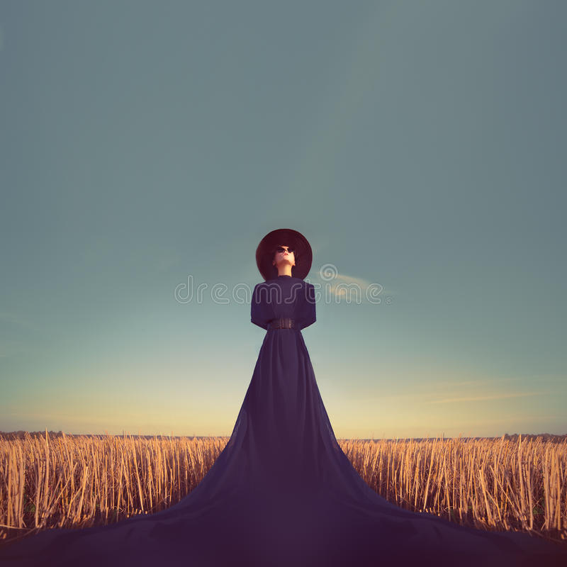 Portrait of a girl in a black dress in the forest royalty free stock photography