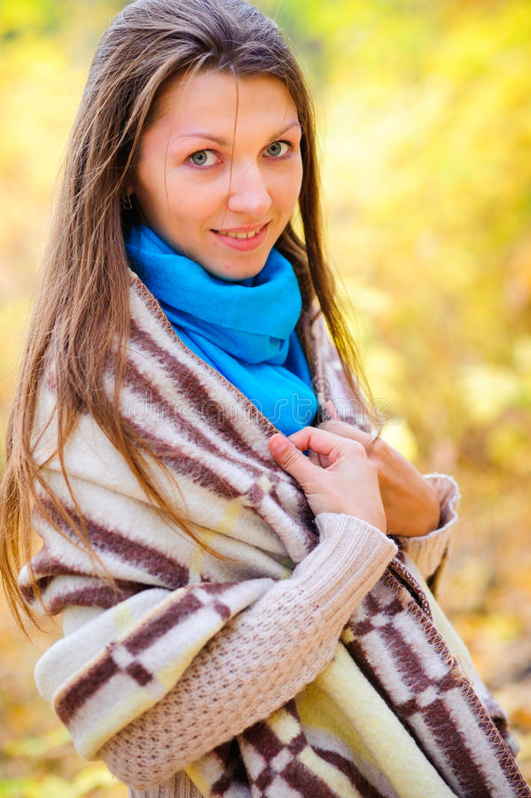 Girl with a blanket outside