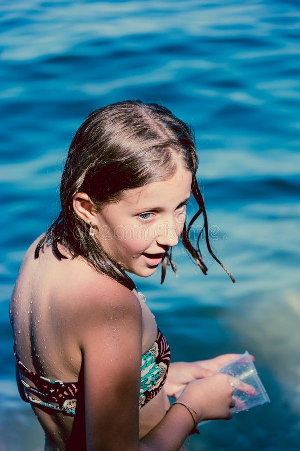 Portrait girl in blue sea royalty free stock photography