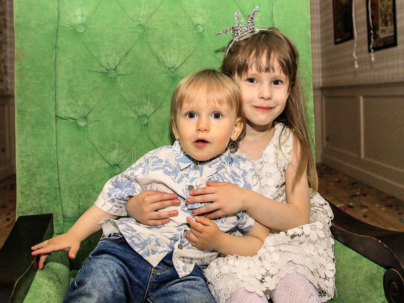 Portrait of a girl and a boy. Brother and sister on holiday. royalty free stock images