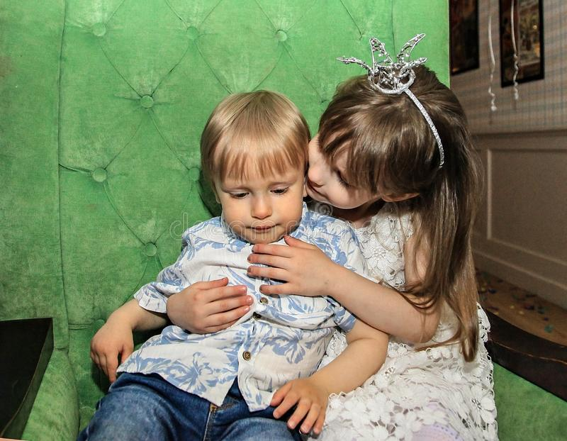 Portrait of a girl and a boy. Brother and sister on holiday. royalty free stock image