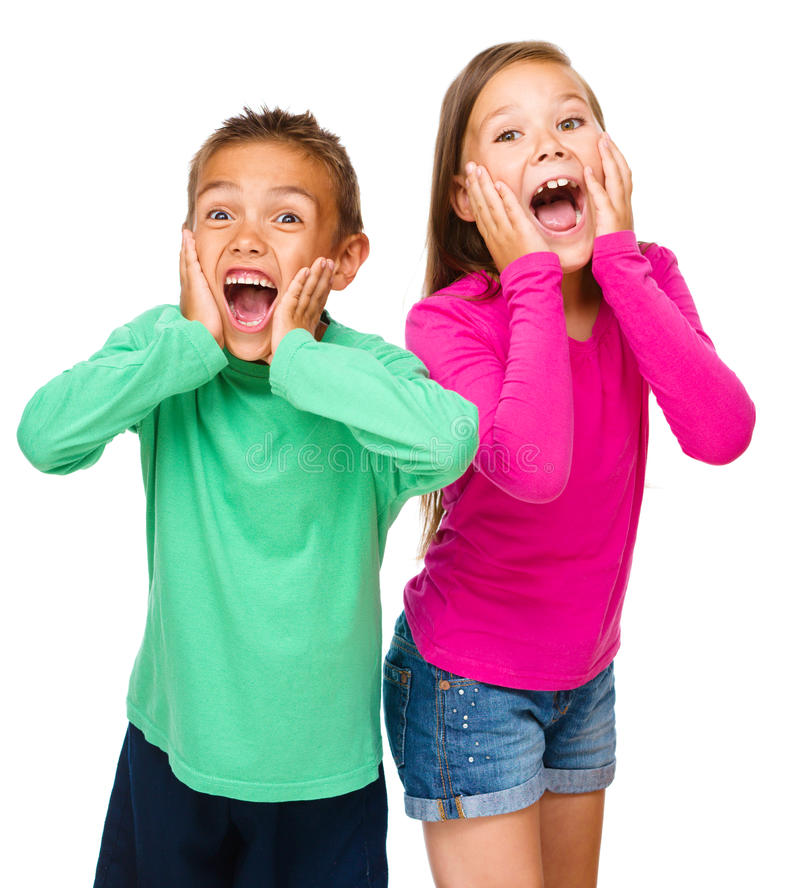 Portrait of girl and boy. Portrait of cute girl and boy holding their faces in astonishment, isolated over white royalty free stock photo