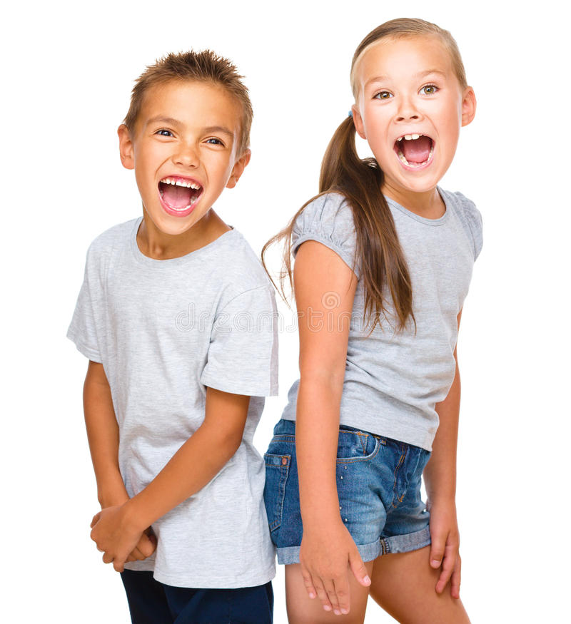 Portrait of girl and boy. Portrait of happy girl and boy, isolated over white stock photo