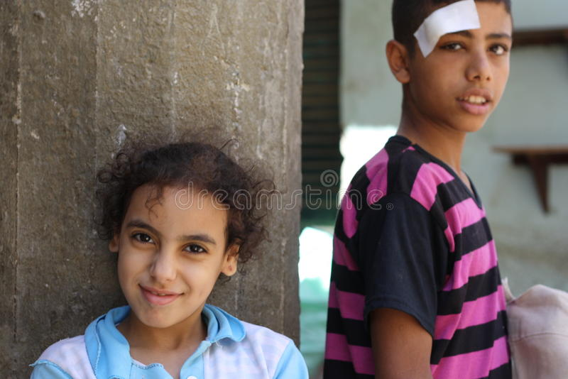 Portrait of a girl and a boy in the street in giza, egypt stock photo