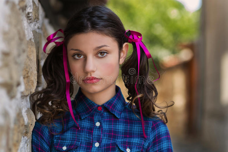 Portrait of a girl with braids. Young girl with braids outdoors stock photography