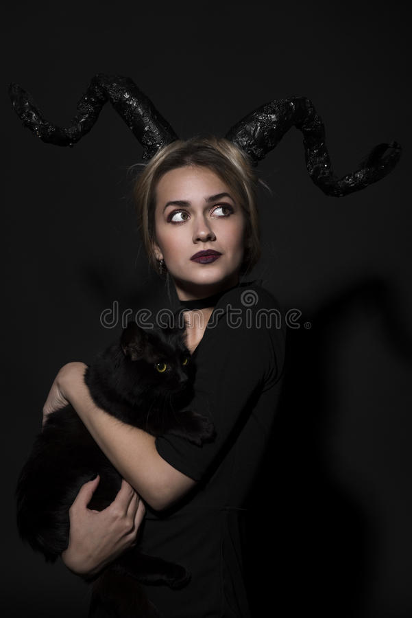 Portrait of a girl with a cat royalty free stock image
