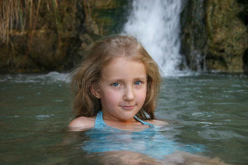 Portrait of a girl child bathing stock image