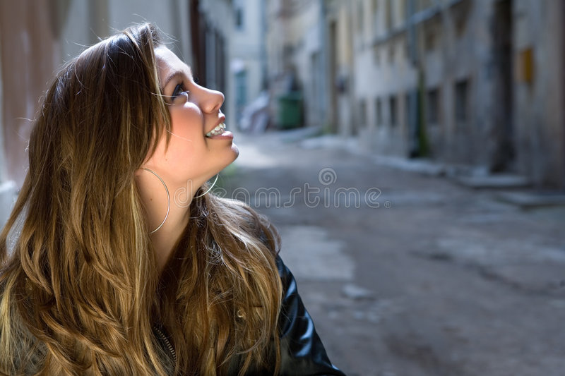 Portrait of the girl in a court yard. Of an old city royalty free stock image