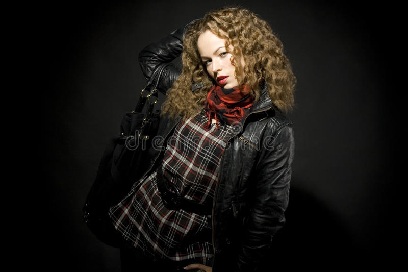 Portrait of a girl with curly hair stock images