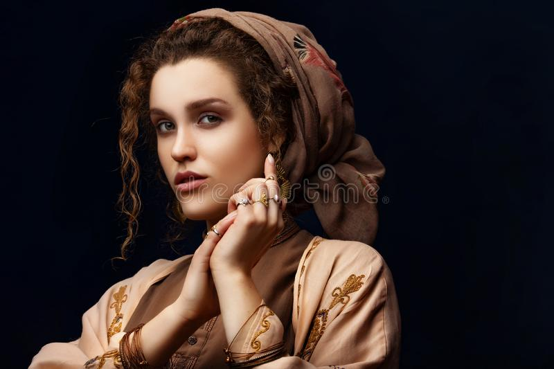 Portrait of a girl with curly hair. dark background royalty free stock photos