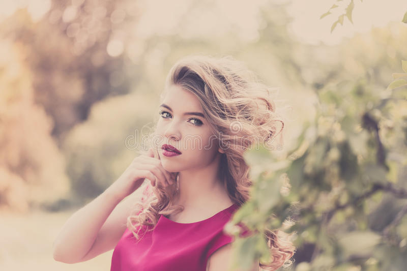 Portrait of a girl with curly hair. royalty free stock photography