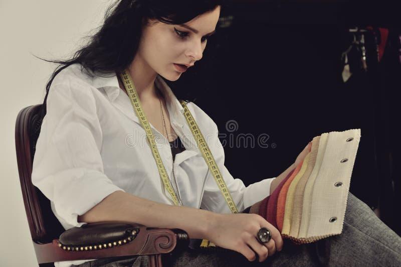 Portrait of a girl dressmaker at work. stock images