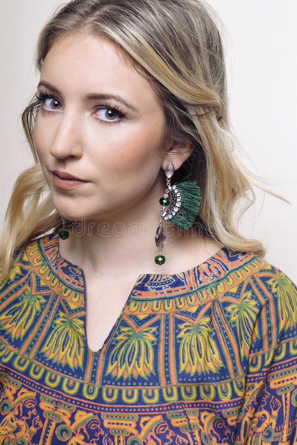 Portrait of a girl with earrings stock photos