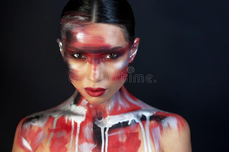 Portrait of a girl of european asian appearance with makeup royalty free stock photo