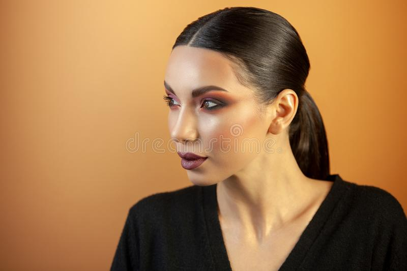 Portrait of a girl of european asian appearance with makeup stock photo