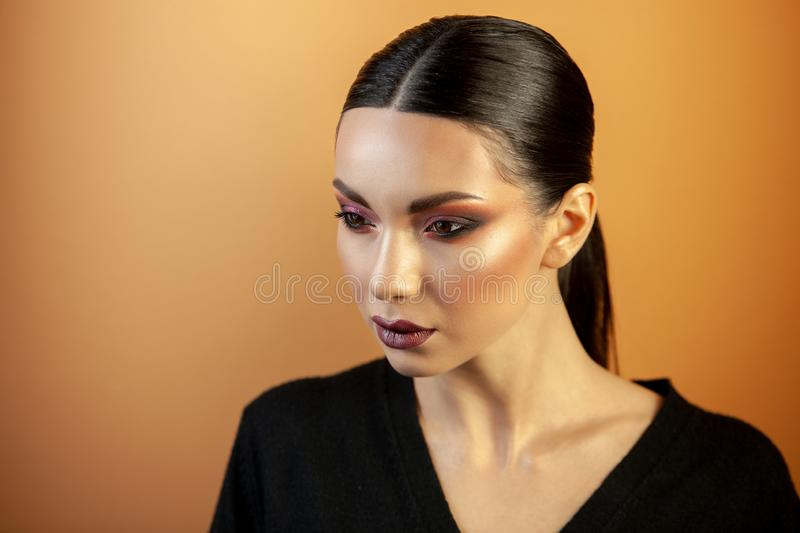 Portrait of a girl of european asian appearance with makeup stock photos