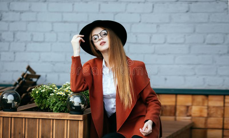 Portrait of a beautiful girl in a hat and coat royalty free stock image