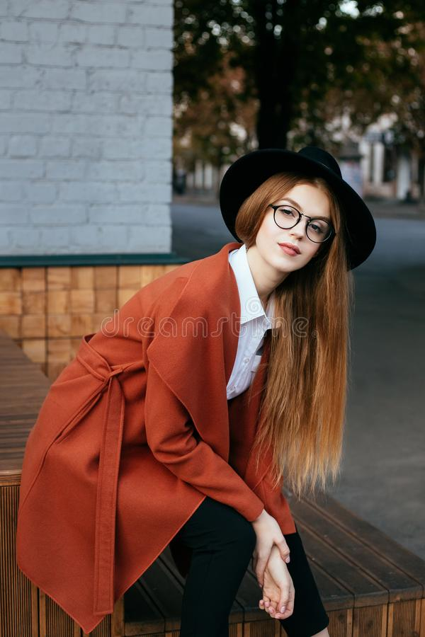 Portrait of a beautiful girl in a hat and coat royalty free stock photography
