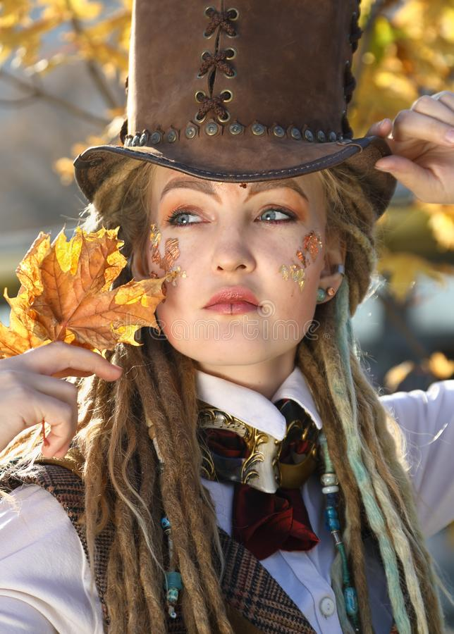 Portrait of a girl in a fantasy clothes and make-up. Portrait of a girl in a fantasy clothes and with make-up in an urban environment in autumn royalty free stock images