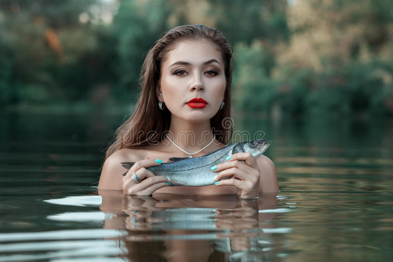 Portrait of a girl with fish. royalty free stock photo