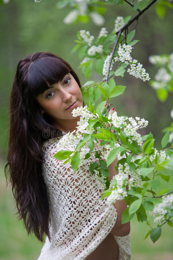 Portrait of a girl with flowers stock photos