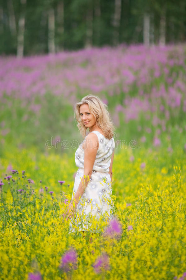 Portrait of a girl with flowers royalty free stock photos