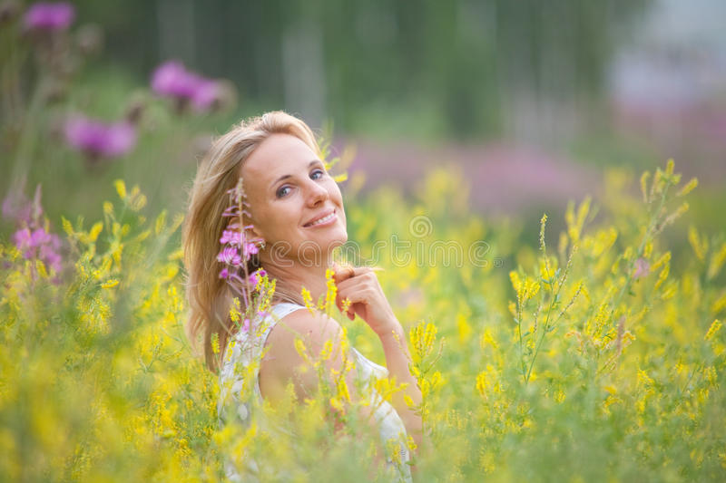 Portrait of a girl with flowers erysimum royalty free stock photo