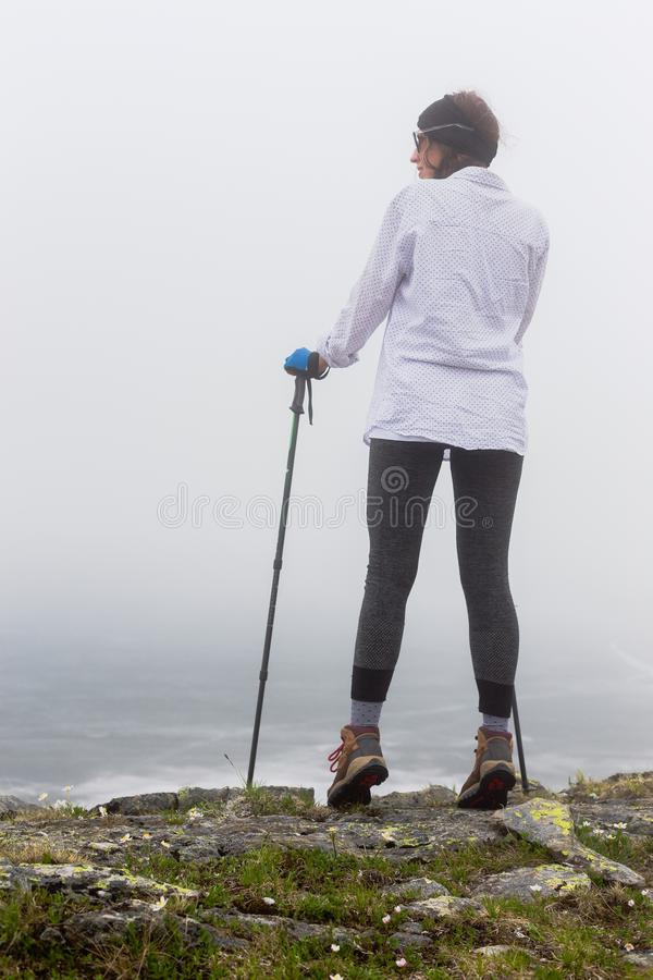 Portrait of a girl in foggy weather. royalty free stock photography