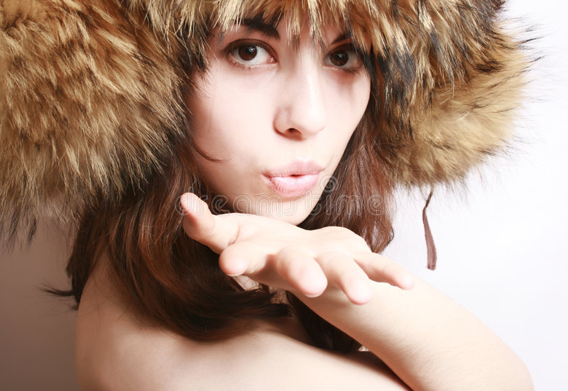 Portrait of the girl in a fur cap. Portrait of the beautiful girl in a fur cap close up royalty free stock photos