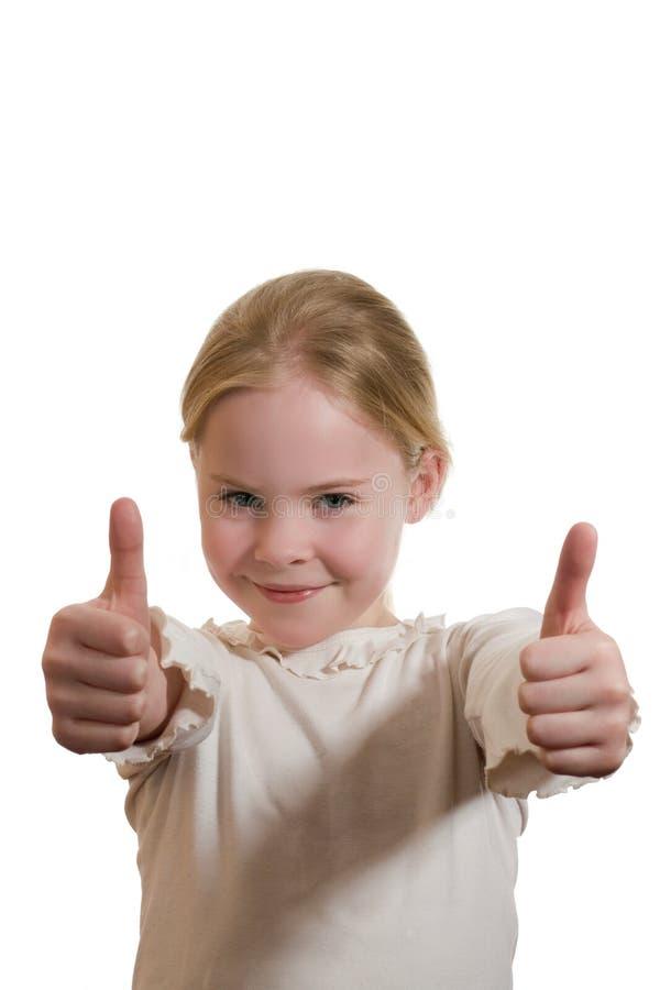 Portrait of girl giving thumb stock photos