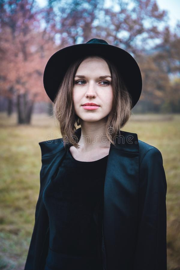 Portrait of a girl in gloomy forest royalty free stock image